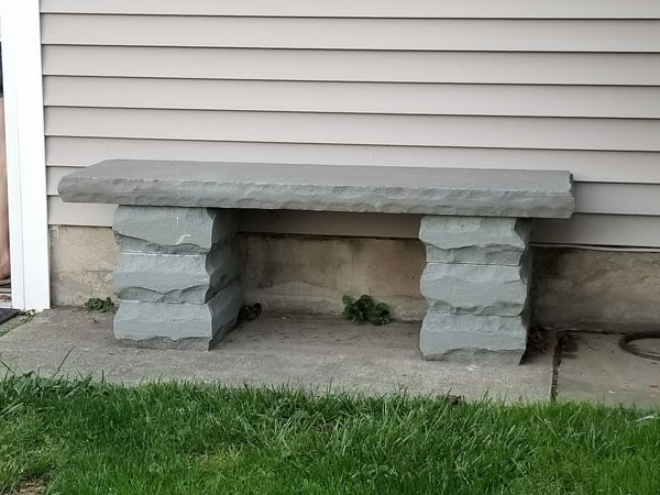 Stone bench with rockfaced edging